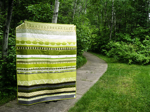 Finished! My spring-green, stripey, silky, stitched up, wool & leather quilt.