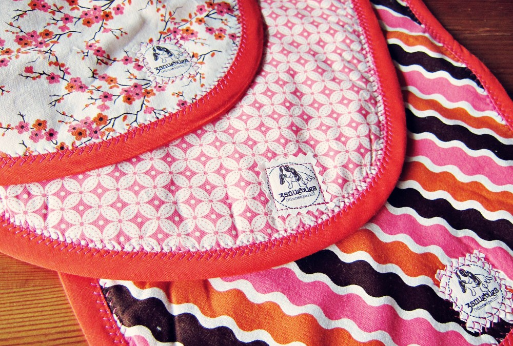 Man-aprons and bibs for teeny necked babies